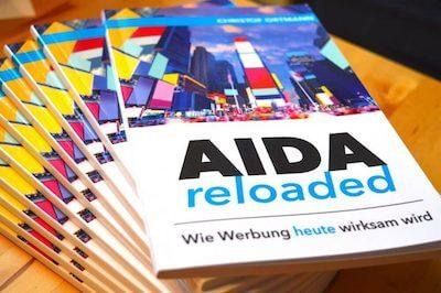 """Buchstapel """"AIDA reloaded - Wie Werbung heute wirksam wird"""" klein"""